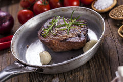 Excellent fried beef served with vegetables and spices Royalty Free Stock Images