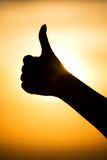 Excellent hand sign silhouette. On bright sun background Royalty Free Stock Photos