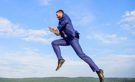 Excellent internet provider raise up quality connection. Internet connection so fast. Man with laptop jump or fly in air. Blue sky background. Boost speed royalty free stock photography