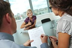 Excellent job interview. Conductors holding questionnaire form during the job interview, applicant's reults are excellent. Focus placed on sheet in front royalty free stock photo