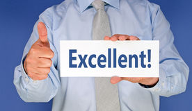 Excellent - Manager holding sign with text. Thumb up stock photos