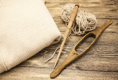 Excellent mocap two old wooden spindle with a ball of wool thread for the manufacture of woolen threads on a wooden background Stock Photos
