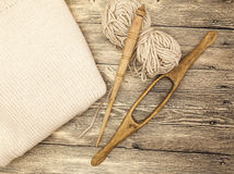 Excellent mocap two old wooden spindle with a ball of wool thread for the manufacture of woolen threads on a wooden background Royalty Free Stock Photography