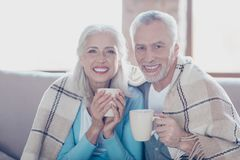 Excellent retirement! Close up portrait of happy delightful excited old people with toothy beaming smile, they are resting, relax. Ing, drinking tea and stock photography