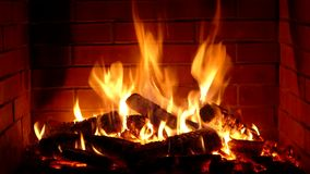 Excellent satisfying close up shot on wood burning slowly with orange fire flame in cozy brickwork fireplace atmosphere. Excellent satisfying close up shot on stock video