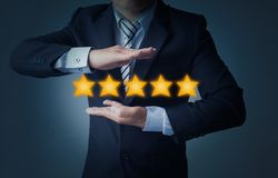 Free Excellent Service And Best Customer Experience Or Good Client , Business Man Showing 5 Stars Rating On Dark Blue Background Royalty Free Stock Image - 160461656