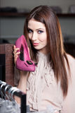 Excellent shoes in the hands of pretty woman Royalty Free Stock Images