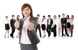 Excellent sign. Smiling business executive women of Asian give you an excellent sign in front of her team isolated on white background stock photo