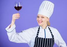 Excellent taste. Sommelier skills. Serving wine at restaurant. Woman chef hold glass of wine. Outstanding toasts that royalty free stock photos