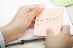 Excellent text on adhesive note Royalty Free Stock Images