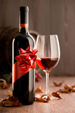 Excellent wine with ribbon and wineglass Royalty Free Stock Images