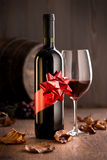 Excellent wine with ribbon and wineglass Stock Photo