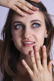 Excellent woman face and accurate manicure close up portrait looking down Stock Photography