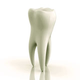 Excellente dent blanche sur un fond blanc Photos stock