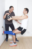 Excentric quadriceps. Physiotherapy in a gym applying excentric quadriceps Stock Image