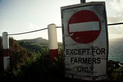 Except for farmers only sign. On the edge of the cliff on the end of the day Royalty Free Stock Images