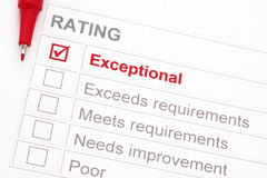 Exceptional Rating. Rating marked exceptional, with red pen. Could be a customer service rating, performance appraisal, educational assessment, etc stock photography