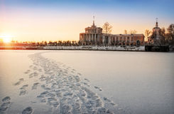 Exceptional winter view. From the frozen river at a river station and a temple Royalty Free Stock Photo