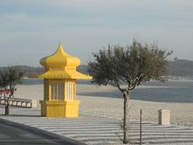 Closed, yellow beach kiosk by the sea with a vaulted dome roof Royalty Free Stock Photo