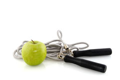 Excercise. And diet with skipping rope and fresh apple Royalty Free Stock Photo