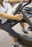 Excercise Bike. Woman during a cardio workout on an exercise bike in the gym royalty free stock image