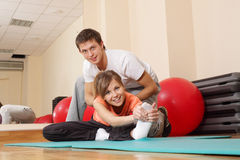 Excercise in health club Stock Photo