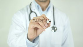 Excercise Regularly, Doctor Writing on Transparent Screen stock footage