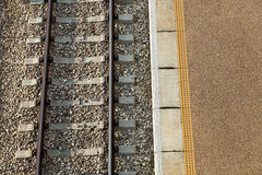 Train Station Platform & Railway. Excerpts of railway track and train station platform, as viewed from directly above Royalty Free Stock Image
