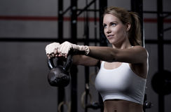 Excersing with kettlebell Stock Photos