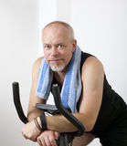 Excersising. Man excersising at home on bicycle Royalty Free Stock Photos