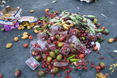Excess. A pile of fruits and vegetables thrown on a street Royalty Free Stock Photography