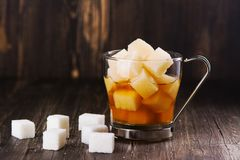 Excessive portion of sugar in mug with tea. Health care or diabetes concept Royalty Free Stock Image