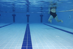 Excessive weight. Underwater picture of a woman (with excessive weight) swimming Stock Images