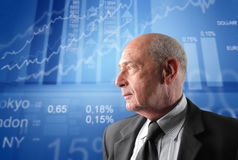 Exchange. Profile of a senior businessman with exchange graphics on the background Royalty Free Stock Photo