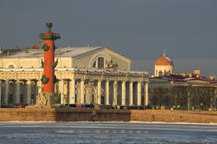 The Exchange building and the South Rostral column sunny february morning. Saint-Petersburg, Russia Royalty Free Stock Photography