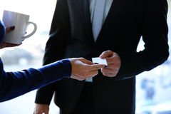 Exchange business card between man and woman Stock Image