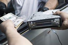 Exchange Of Car Radio For Cash. Extreme closeup exchange of car radio for cash stock images
