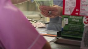 Exchange the coins to by a ticket. stock footage