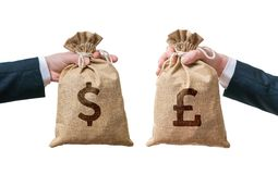 Exchange currency concept. Hands hold bag full of money - Dollar and British pounds.  Stock Photos