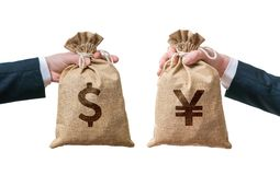 Exchange currency concept. Hands hold bag full of money - Dollar and Yen Stock Images