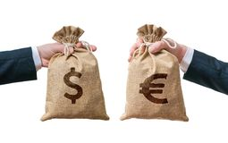 Exchange currency concept. Hands holds bags full of money - Dollar and Euro Stock Photography