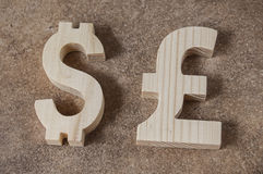 Exchange currency DOLLAR with POUND unit on a stone background Stock Photo