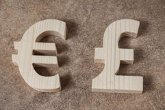 Exchange currency EURO with POUND unit on a stone background Stock Images