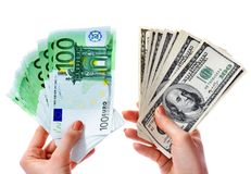Exchange dollars to euro money in female hand. Stock Photo