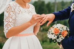 Exchange of gold rings at wedding ceremony between bride and groom Royalty Free Stock Photography