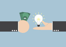Exchange light bulb idea and money Stock Photography