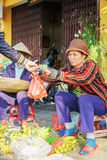 Exchange of money and goods in the street market Royalty Free Stock Image