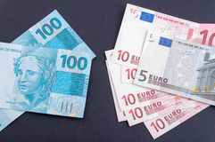 Exchange rate. Brazilian money and European money stock photography