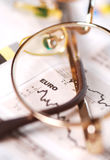 Exchange rates. Chart in newspaper with glasses royalty free stock photography