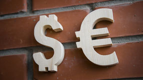 Exchange rating. Currency sign Euro, Dollar on brick wall Royalty Free Stock Images